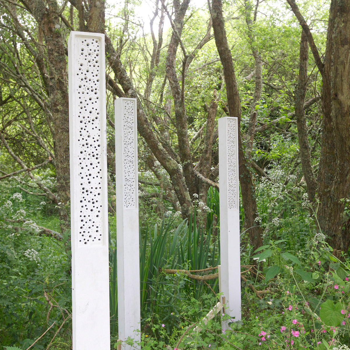 beepost bee towers in forest land landscaping