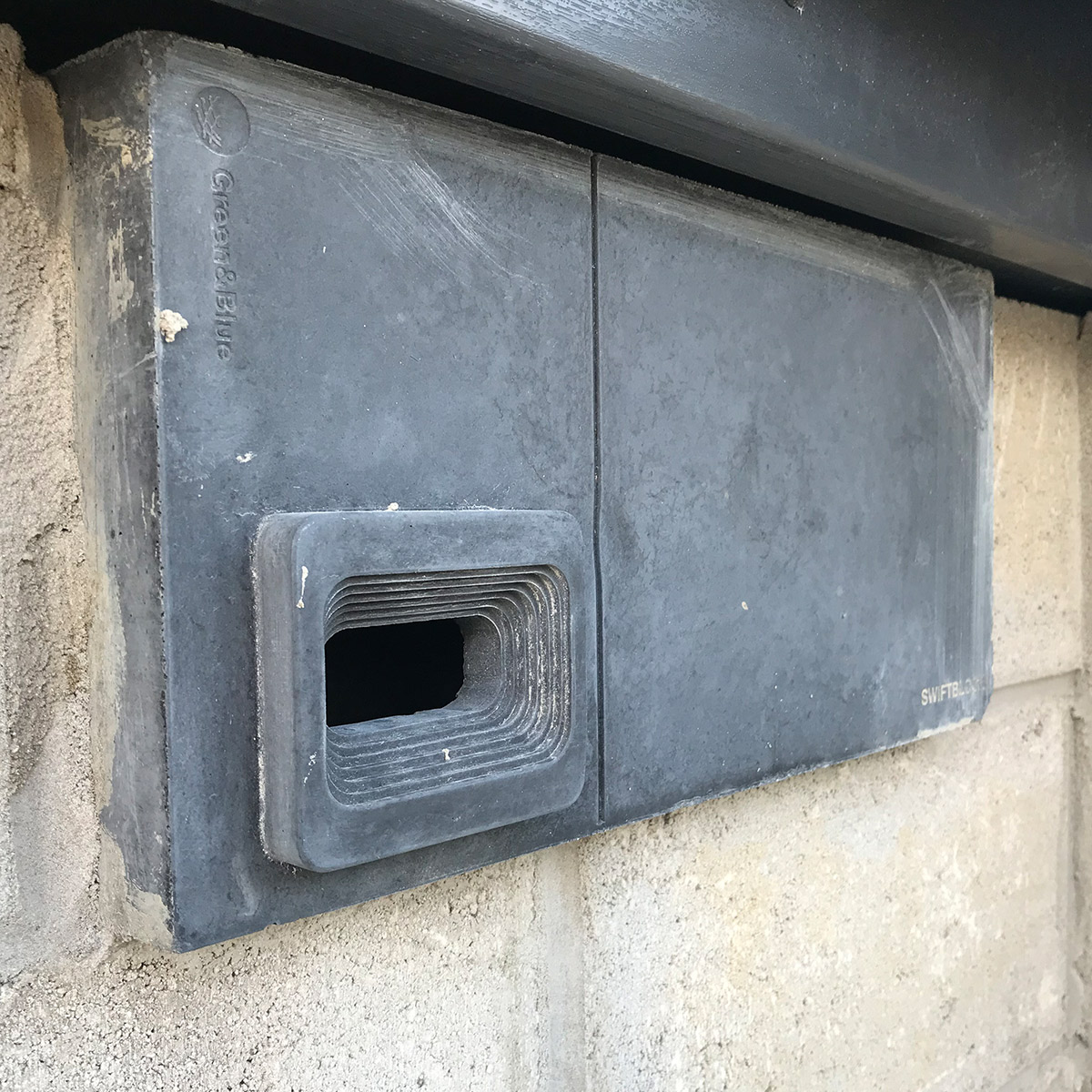 charcoal swift block being installed