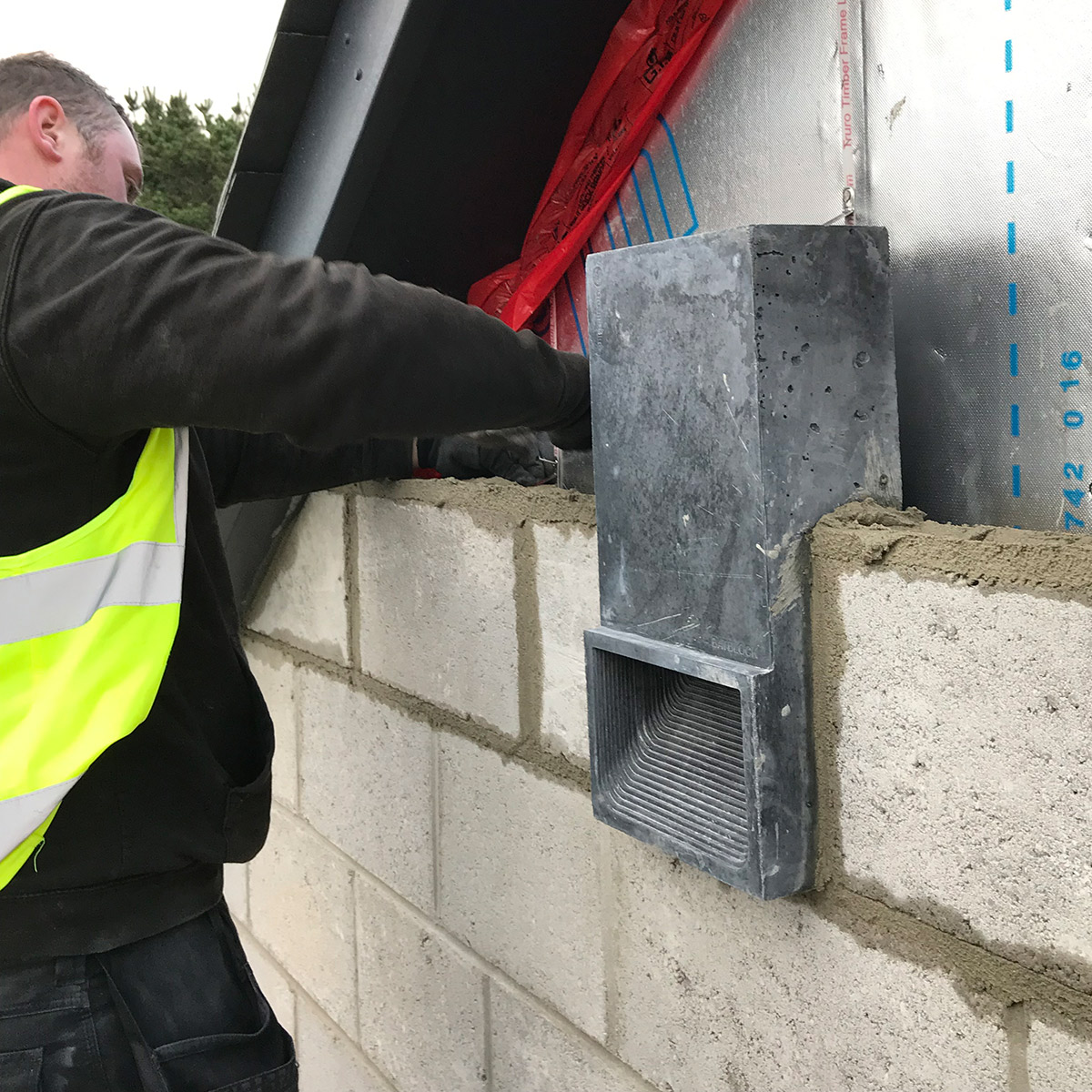 charcoal bat block being installed